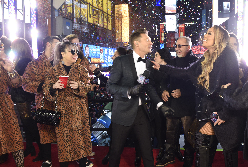 "Ryan Seacrest (center) and Mariah Carey (far right) on ""Dick Clark's New Year's Rockin' Eve with Ryan Seacrest 2017"""