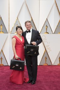 PriceWaterHouse Coopers employee Brian Cullinan (pictured at right) on the Oscar red carpet before the show at the Dolby Theatre on February 26, 2017.