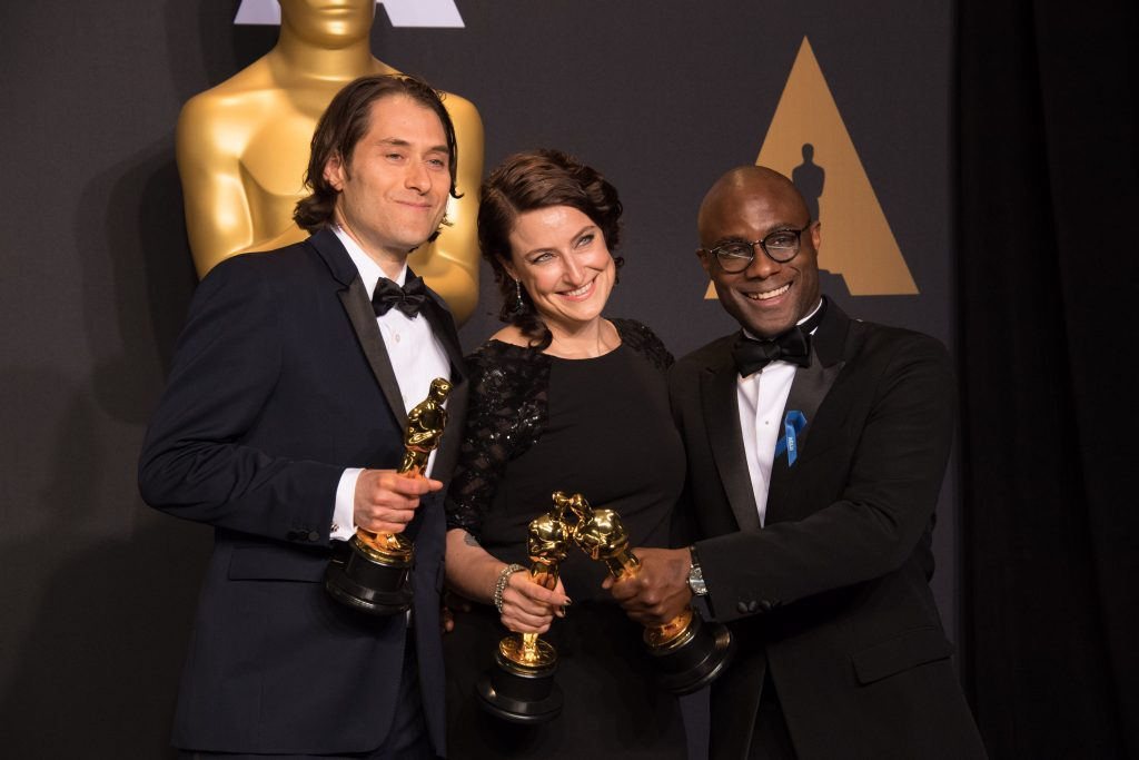 Jeremy Kleiner, Adele Romanski and Barry Jenkins at the 2017 Academy Awards in Los Angeles.