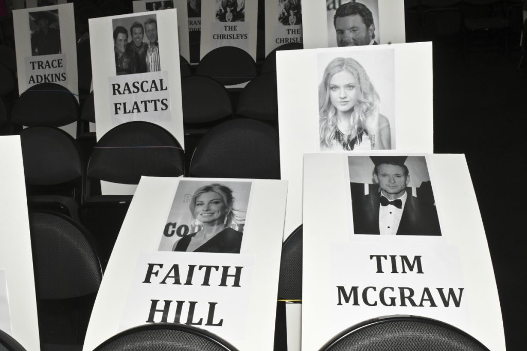 Seat cards for the 52nd ACM Awards at T-Mobile Arena in Las Vegas on March 31, 2017.