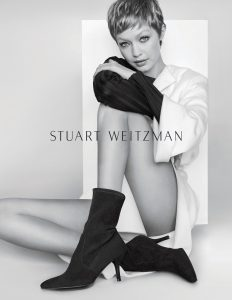 Gigi Hadid wearing Cling boots in Stuart Weitzman's Fall/Winter 2017  Campaign (Photo by Mario Testino/Stuart Weitzman)