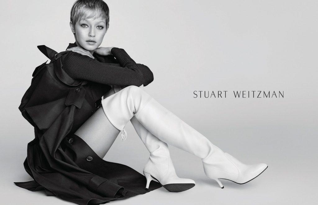 Gigi Hadid wearing Tiemodel boots in Stuart Weitzman's Fall/Winter 2017  Campaign (Photo by Mario Testino/Stuart Weitzman)